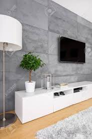 Living Room With Modern Concrete Wall Television Lamp And Cabinet