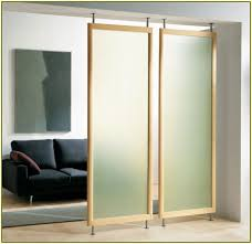 two panels of Ikea room partition with wood frame an elegant black sofa an  abstract painting. Wall divider ...