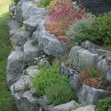 making your own artificial rocks is a cost effective way to add interest to garden landscaping or design unique water features