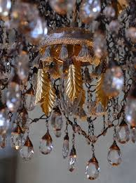 gilded leaves glass berries and 1 100 english chained pearls this classic and sophisticated chandelier consists of a cascade of bright crystals which make