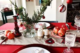 I scattered small pine cones and other natural elements along the table  runner and added a couple of inexpensive sparkly green mini Christmas trees.