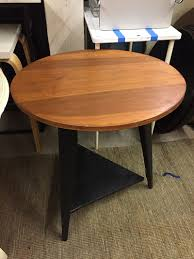 round wood and black side table