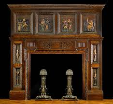 an antique carved wood elizabethan style fireplace mantel