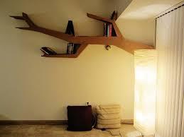 picture of tree branch bookshelf