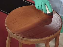 Best way to clean wood furniture Homemade Apply Stain With The Grain Not Against It Todays Homeowner How To Stain Wood Furniture Howtos Diy