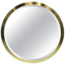 largescale round beveled mirror with brass frame at stdibs