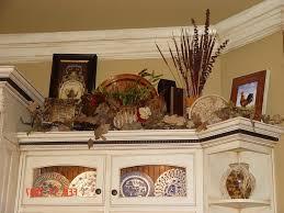 above kitchen cabinet decorations. Decorating Ideas Above Kitchen Cabinets Dark Cupboard Cabinet Wonderful Large Window White Wooden Decorations