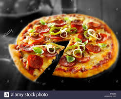 whole cheese pizza sliced. Simple Sliced Whole Pepperoni U0026 Cheese Pizzas With A Slice Being Taken Out Throughout Cheese Pizza Sliced O
