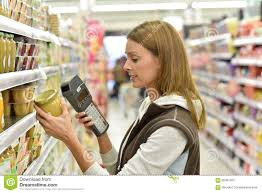 s assistant customer in clothing store stock images s assistant in grocery store scanning products royalty stock photo