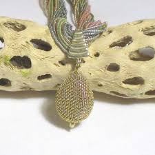 multi strand necklace with gold beaded bead pendant