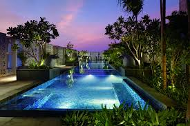 beautiful ritz lighting style. Evening View From The End Of A Rectangular Swimming Pool Surrounded By Plants Beautiful Ritz Lighting Style