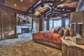 rustic dark toned large master bedroom with carpeted floor wood ceiling wood walls