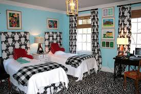 breathtaking kids bedroom applying blue accent wall color with white nightstand between twin beds and furnished charming kids desk