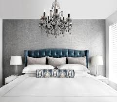 blue velvet tufted headboard with charcoal gray accent wall