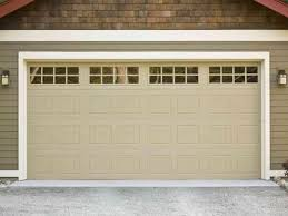 replacing your garage door we answer your top cost concerns