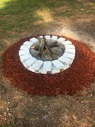 Cheap Way To Update Your Fire Pit Spray Paint The Brick And Put Red Mulch Around Brick Fire Pit Backyard Landscaping Backyard Landscaping Designs