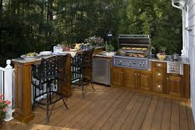 Outdoor Kitchen Lighting Interesting Outdoor Kitchen Idea With Bar Stools And Nice Lighting