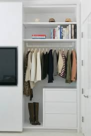 simple closet system with contemporary white drawers and floating shelving cool flat screen tv built into closet la closet design