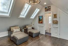 4 tags Traditional Attic with Pendant Light, Hardwood floors, Skylight,  Cathedral ceiling