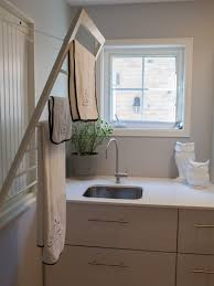furniture transitional laundry room fold out pull down drying fold out laundry rack
