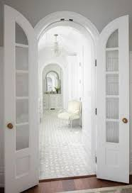 master bathroom with arched bi fold doors transitional bathroom perfect for the bedroom bath archway situation arched french doors o65