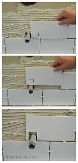 how to cut around fixtures when tiling tub walls