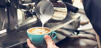 Barista making coffee with waiter. How To Become A Top Level Barista