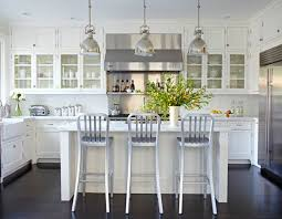 white kitchen dark wood floor. Traditional Home Stainless Steel Vent Hood White Kitchen Glass Front Cabinets Dark Wood Floor I