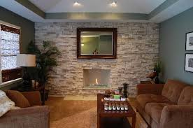 this beautiful stone fireplace has stacked stones encompassing the entire back wall