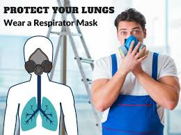 worker with a paint respirator mask to protect lungs