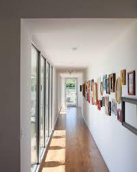 gallery wall is filled with framed pictures and a few empty frames design hufft