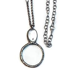 magnifying glass necklace on adjule matte silver chain