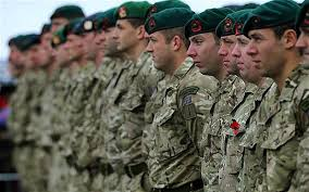 royal marine mandos taking part in a remembrance day service on plymouth hoe in 2016