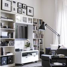 small room furniture solutions. black and white room with wall shelving small furniture solutions
