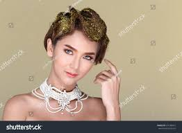 beautiful high fashion make up hair style glitter fancy with crystal sparkling wink pearl necklace