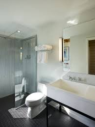 stunning corrugated steel farmhouse bathroom with interesting galvanized corrugated metal shower and vanity light and