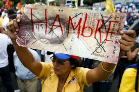 photos venezuelans contend food medicine shortages as low a w holds up a giant hundred bolivar note the word hungry