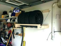 storage rack garage wheel tire what a great idea wakeboard wall