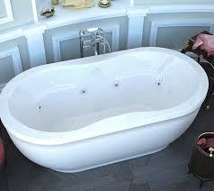 venzi velia 34 x 71 x 21 oval freestanding whirlpool jetted bathtub with center drain by