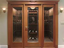 a vint full glass wine cellar door creates an elegant in the home entrance