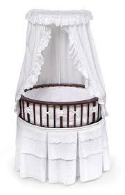 cherry elite oval bassinet with white eyelet bedding
