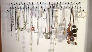 The door to the attic is in my bedroom, so I put these tie racks on the  wall right inside the door. They're perfect for storing necklaces.