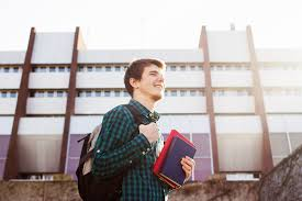 essay contest tell this company why your school rules for k miling young student man holding a book and a bag on a university background