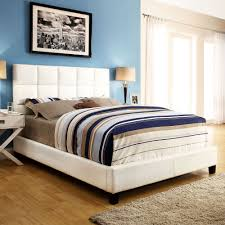 White platform bed with colorful bedding bedroom luxury beds