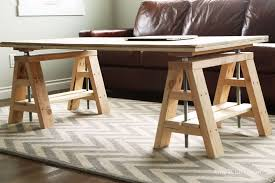 modern indsutrial adjule sawhorse desk to coffee table