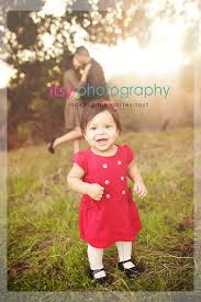 family of three outdoor field photography family photos posing ideas red and black colors