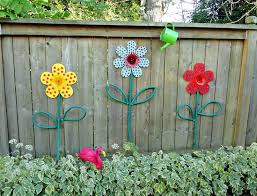 garden craft ideas. dollar store flowers turned into garden art with hoses for leaves and stems craft ideas r
