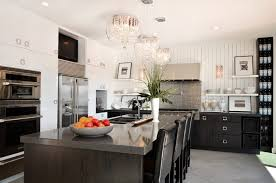 home a great crystal chandelier with case for glamorous black kitchen design with black kitchen island and cabinet also exciting white built in racks