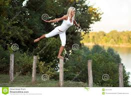 Woman Balancing On Fence Post Stock Photo Image of white bare