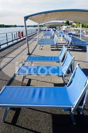 lounge chairs on cruise boat deck